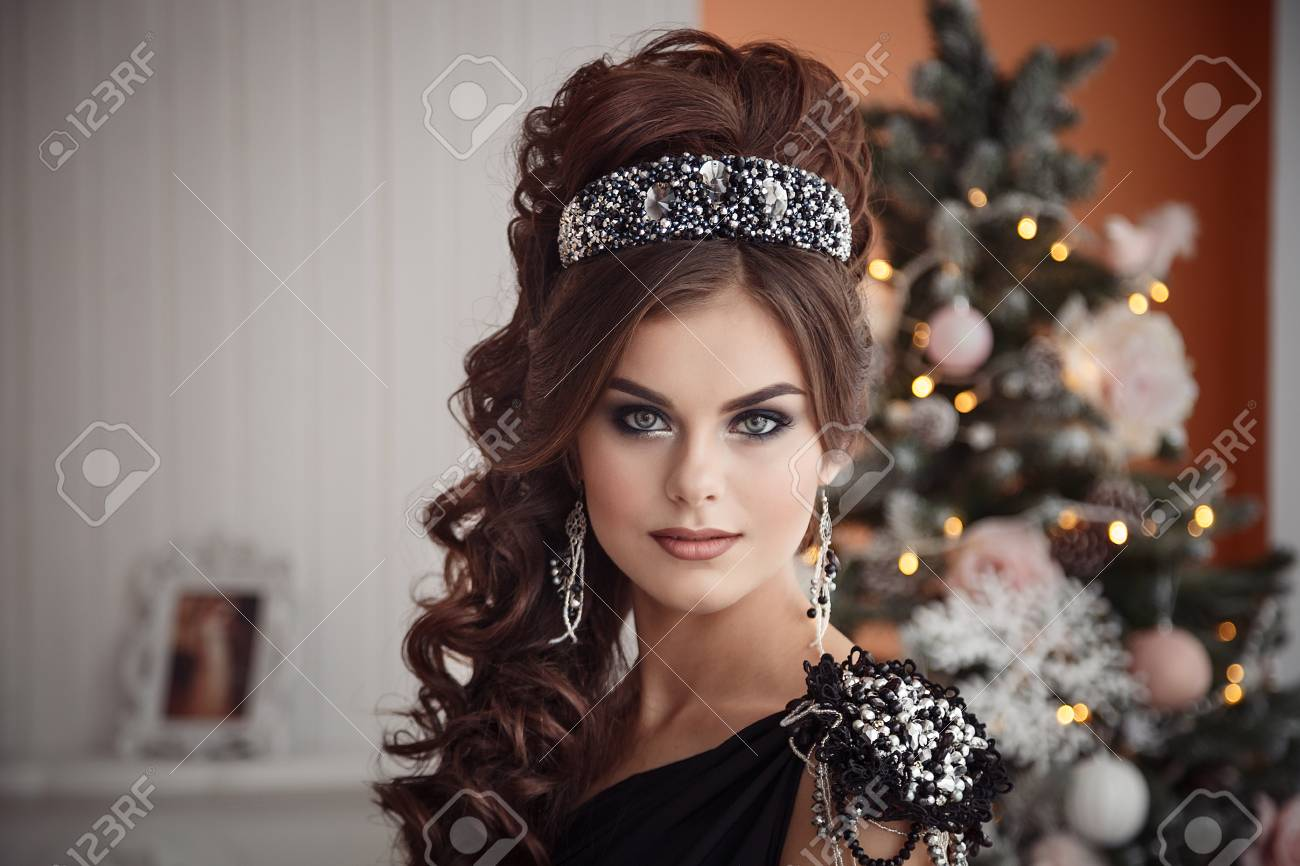 Christmas Hairstyles For Black Girls.Gorgeous Young Woman In Black Dress With Perfect Makeup And Hairstyle