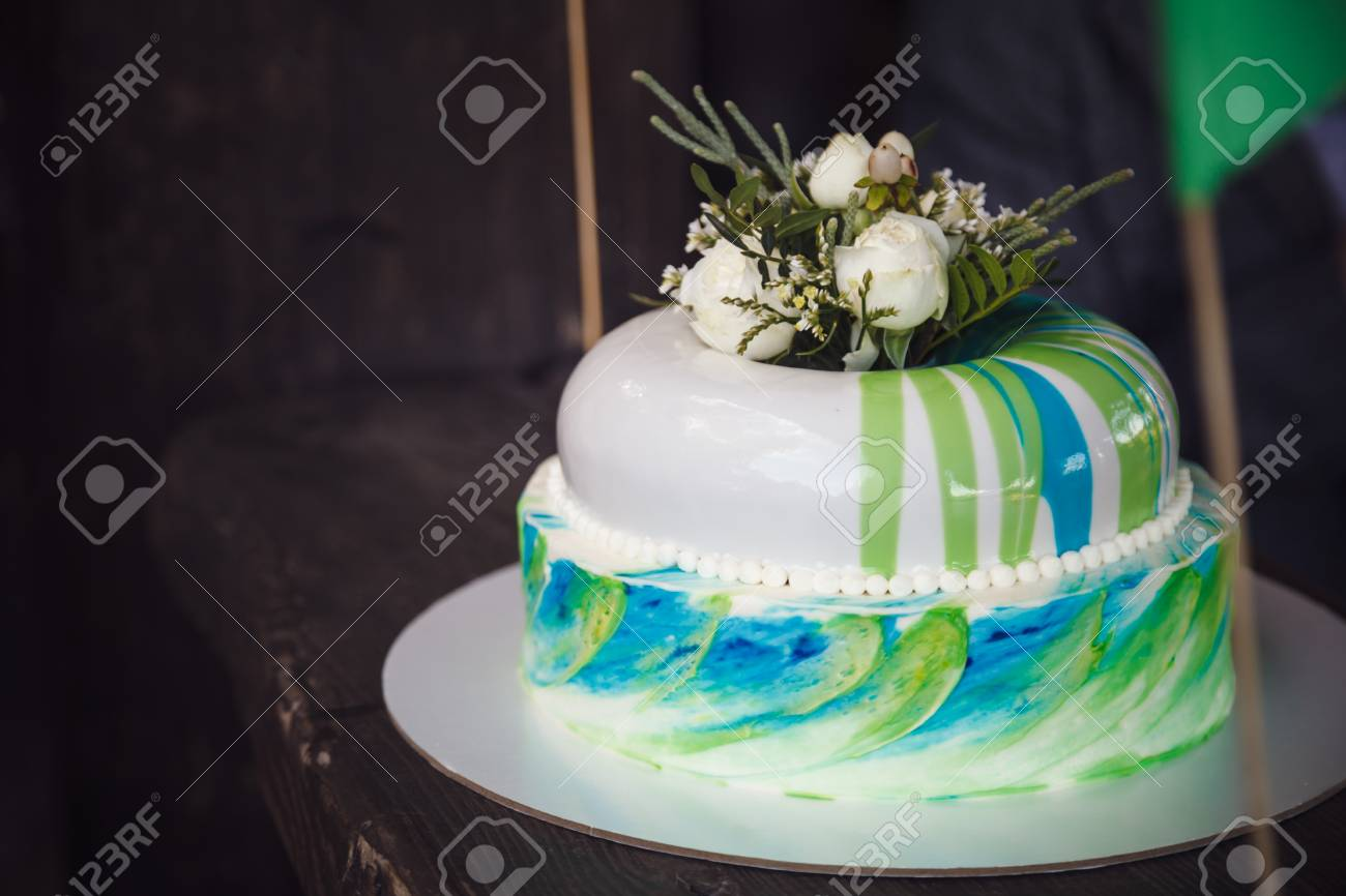 Birthday Cake Decorated By Flowers On Wood Background Stock Photo