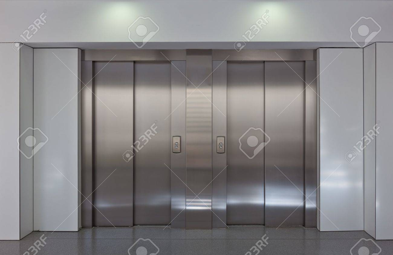 Stock Photo   Two Brushed Metal Elevator Doors In A Minimalistic Style  Building Interior