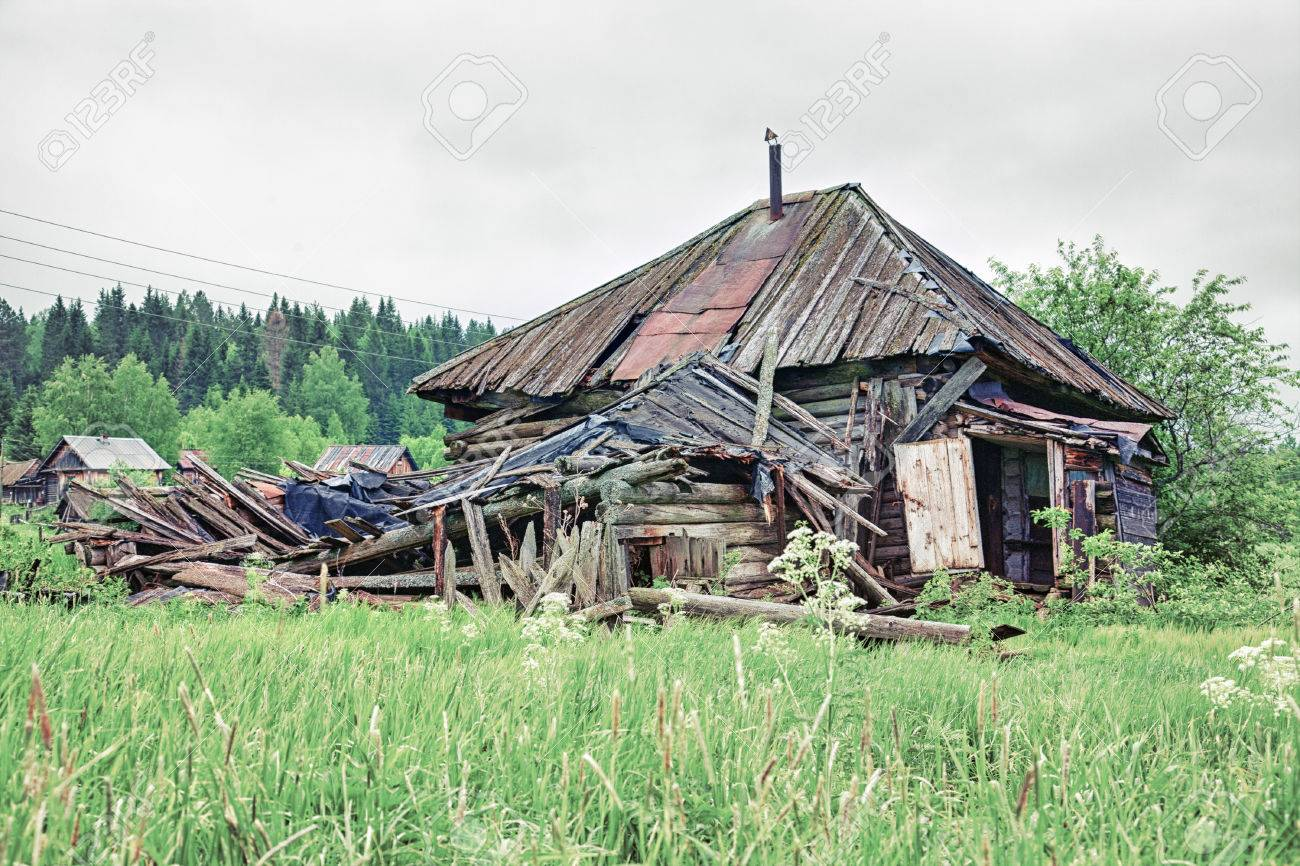 Old Small Abandoned And Ruinous Country House In Russia Stock Photo