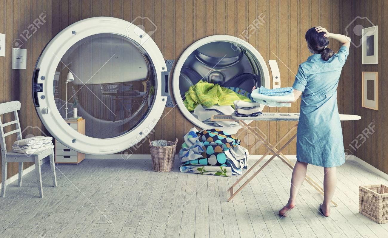 Woman and the Big Wash. Creative concept Standard-Bild - 44925959