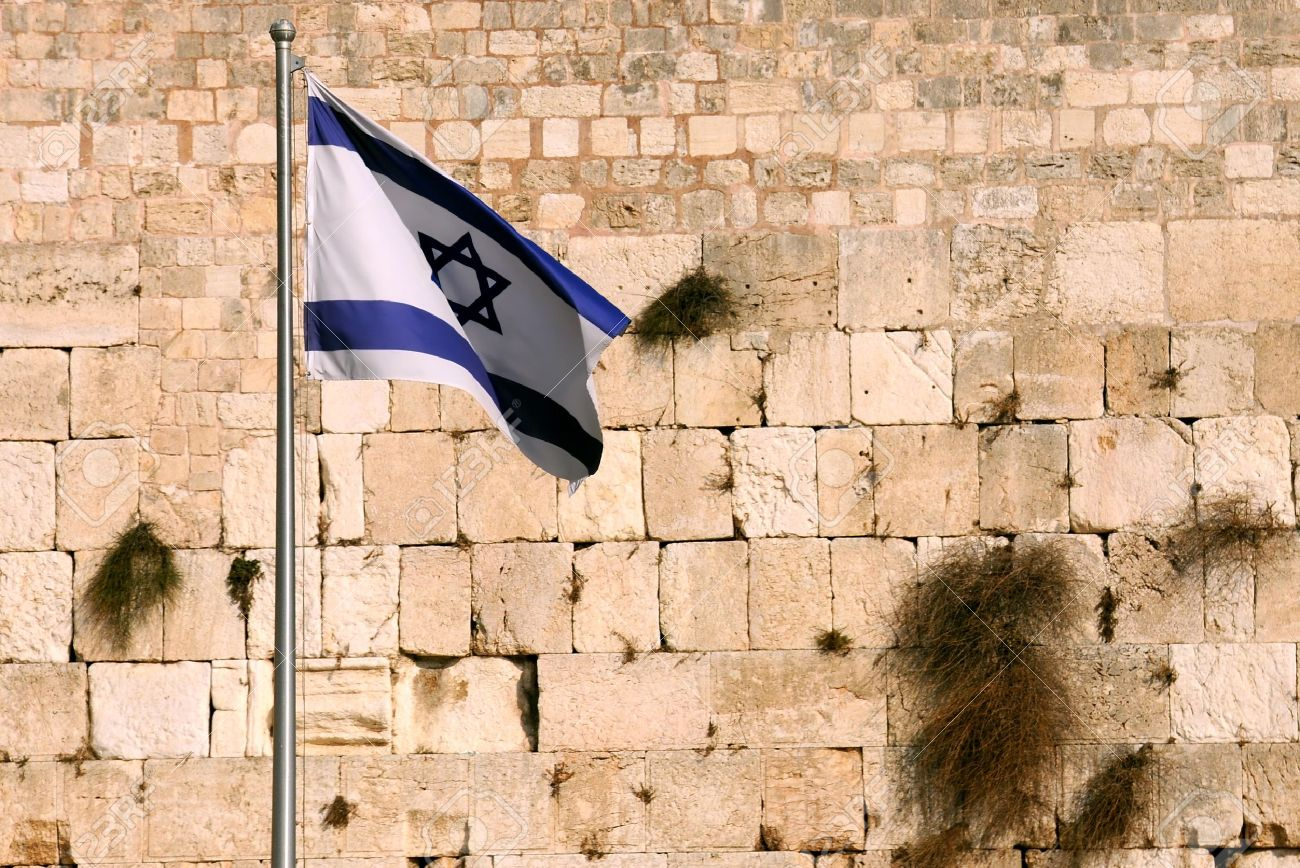 State flag of Israel against the background of the Wailing wall in Jerusalem, Israel. Stock Photo - 9293285