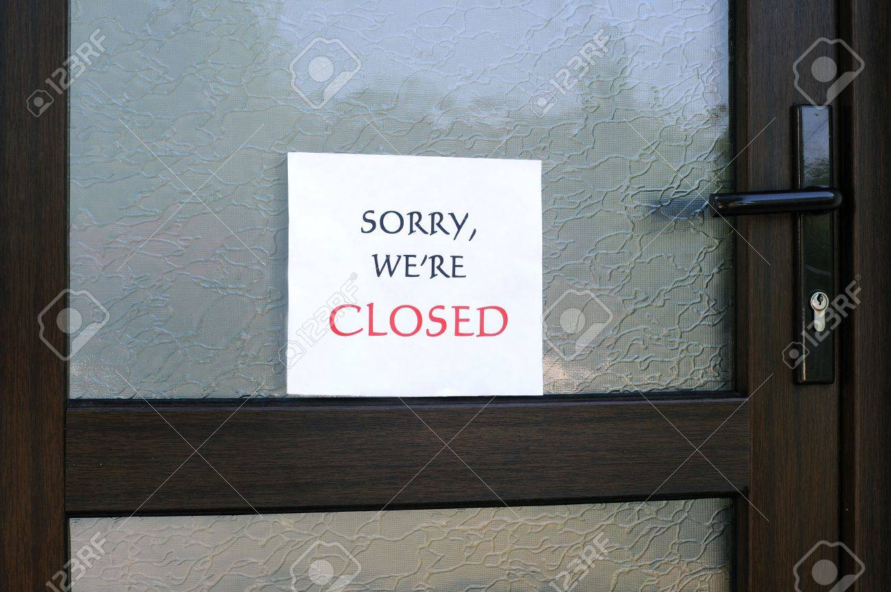 Sorry Were Closed Sign On The Front Door Of A Little Store Stock