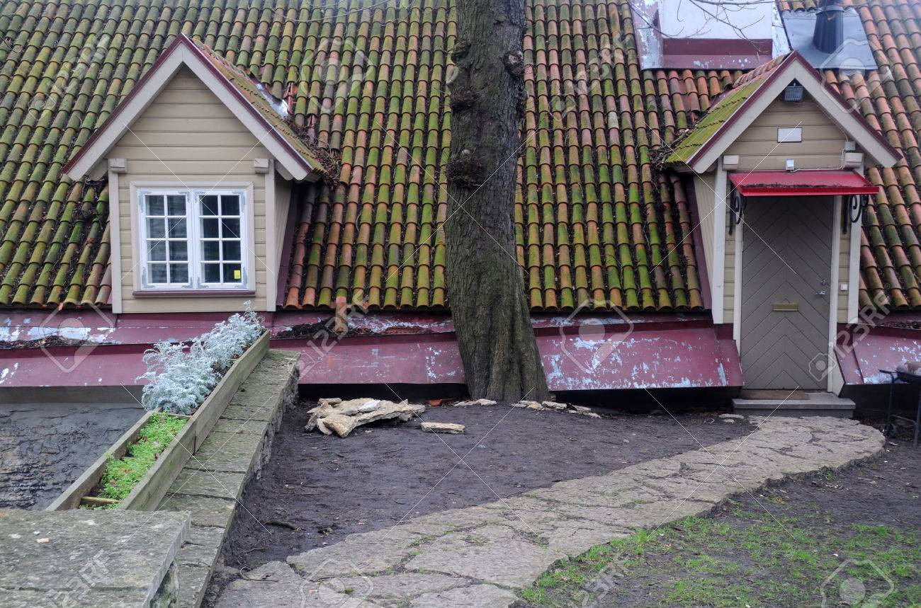 House With Attic part of the house with attic, entrance and old tiled roof in