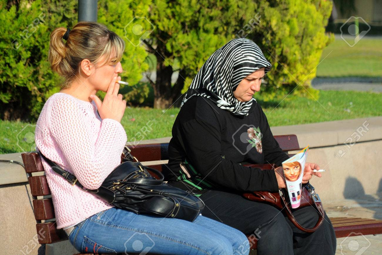 Izmir Turkey October 1 2009 Two Turkish Women Smoke On The Stock Photo Picture And Royalty Free Image Image 25476698