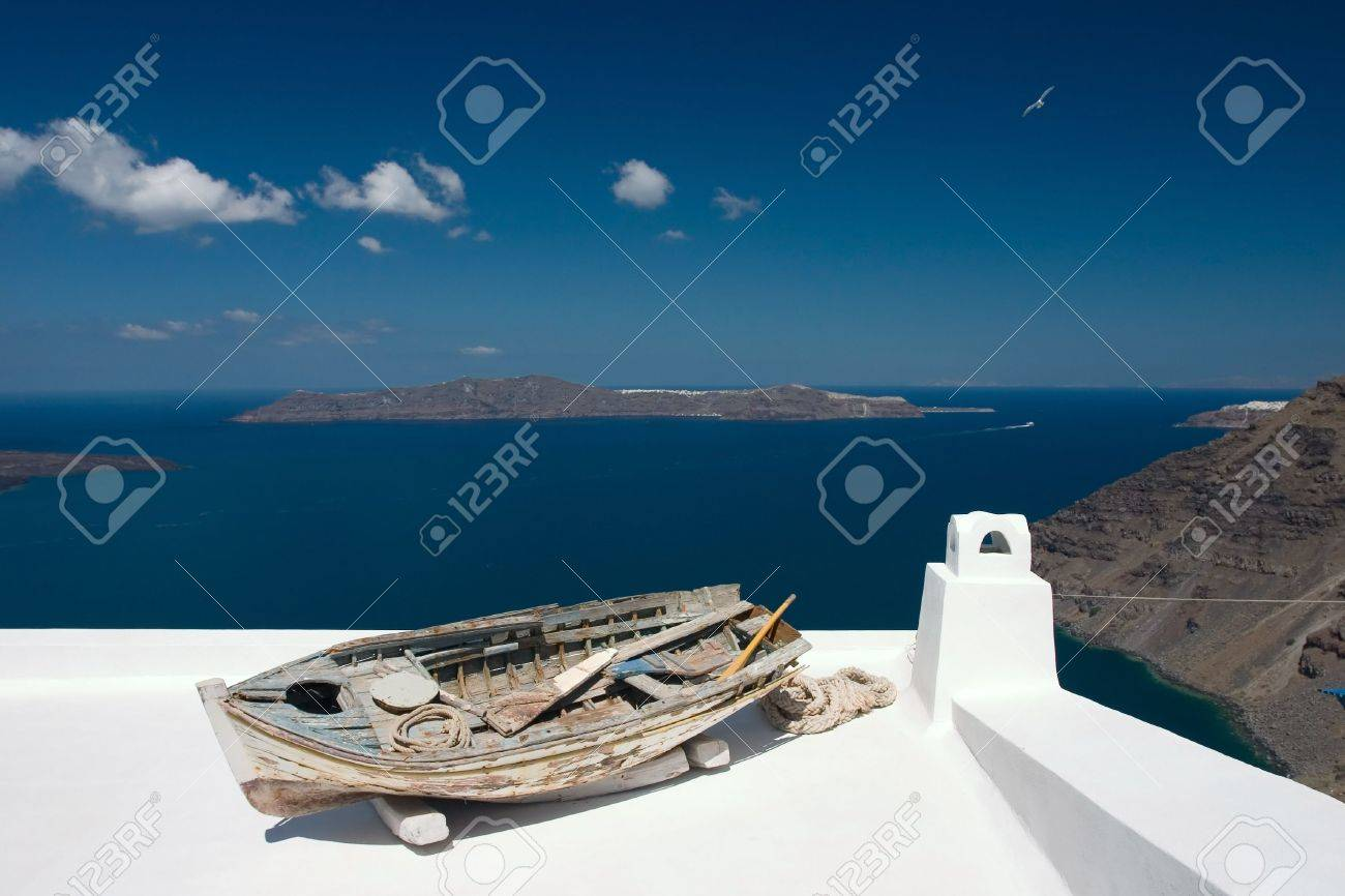 Old damaged rowing boat placed on house roof - 1356923