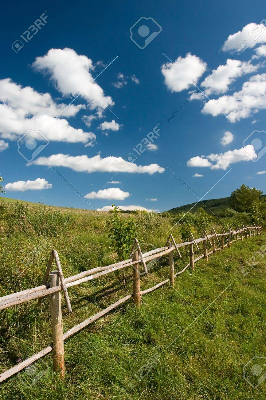 East European summer landcape with wooden fence and beautiful clouds Stock Photo - 1414829
