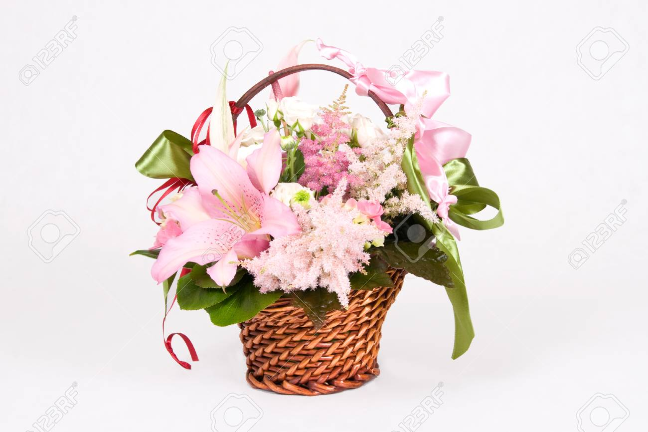 Basket full of variety flowers and green bow - 1414747