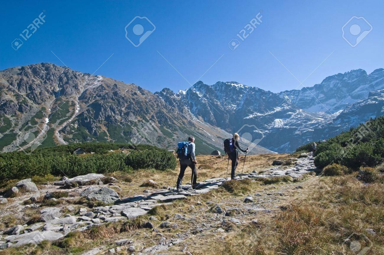 Couple trekking in Tatra Mountains during late autumn, Poland - 2291461