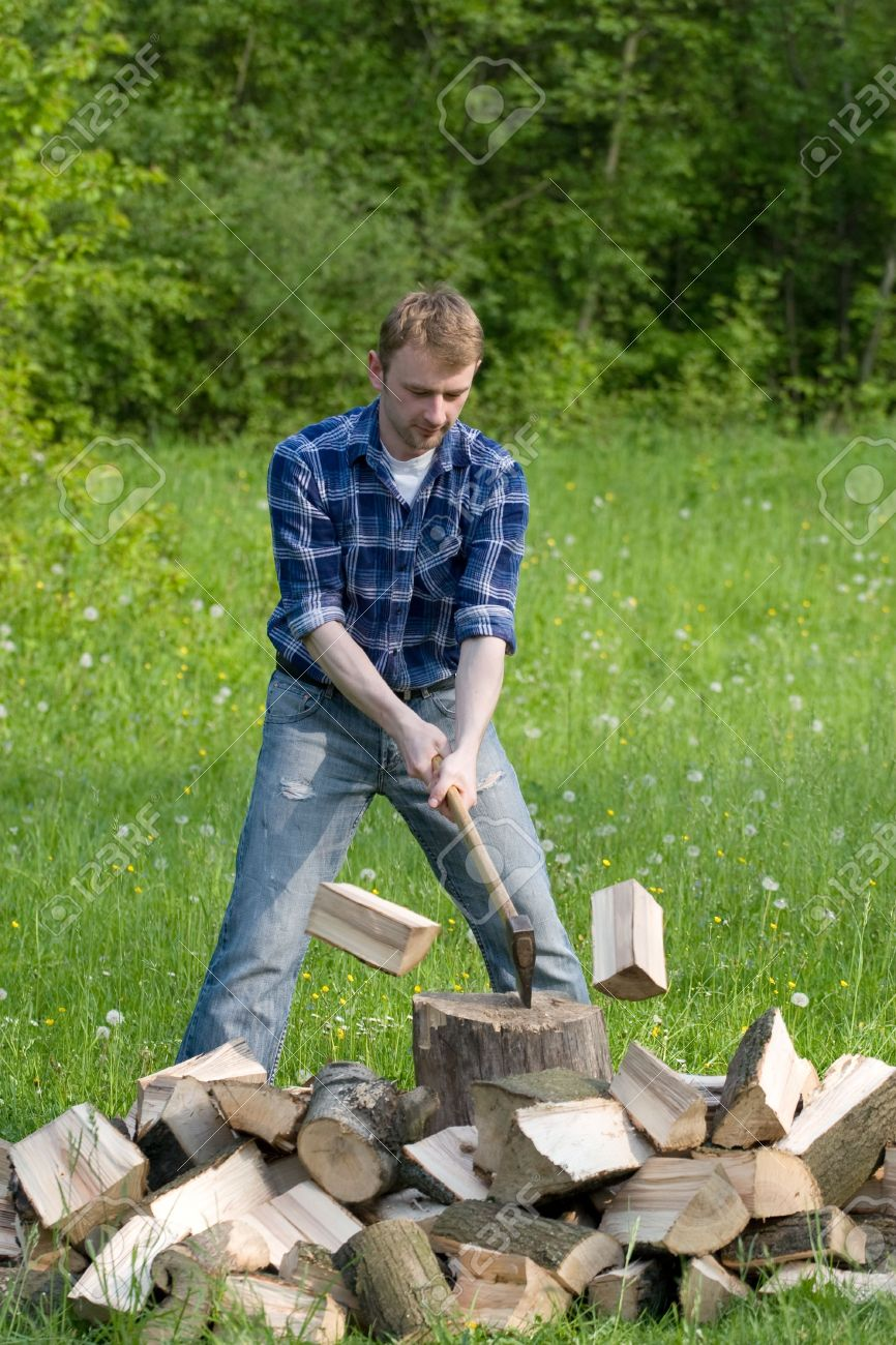 Young man is chopping wood - 3040824