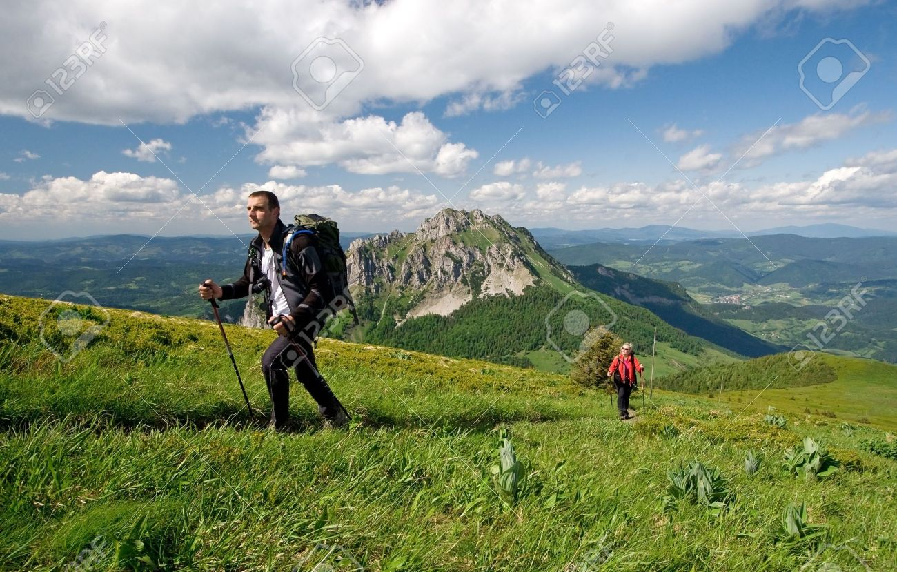 Couple is hiking in mountains, Mala Fatra, Slovakia. Velky Rozsutec in background - 5067265