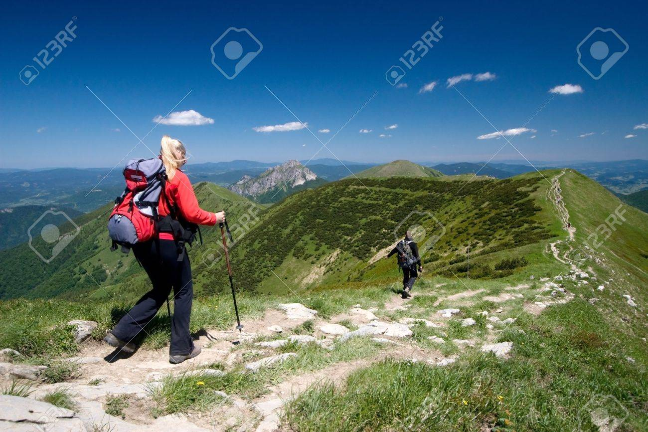 Couple is hiking in mountains, Mala Fatra, Slovakia. Velky Rozsutec in background - 5067261