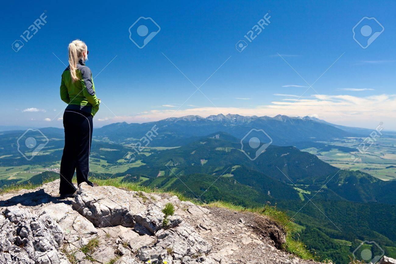 Girl on the top of Velky Chocz in Slovakia. Tatras Mountains far away. - 7434113