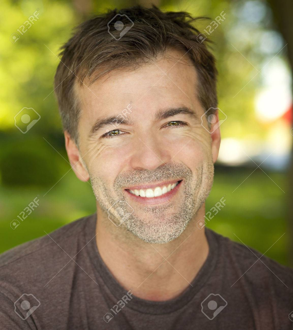 Portrait Of A Mature Confident Man Smiling At The Camera Stock Photo - 33305986