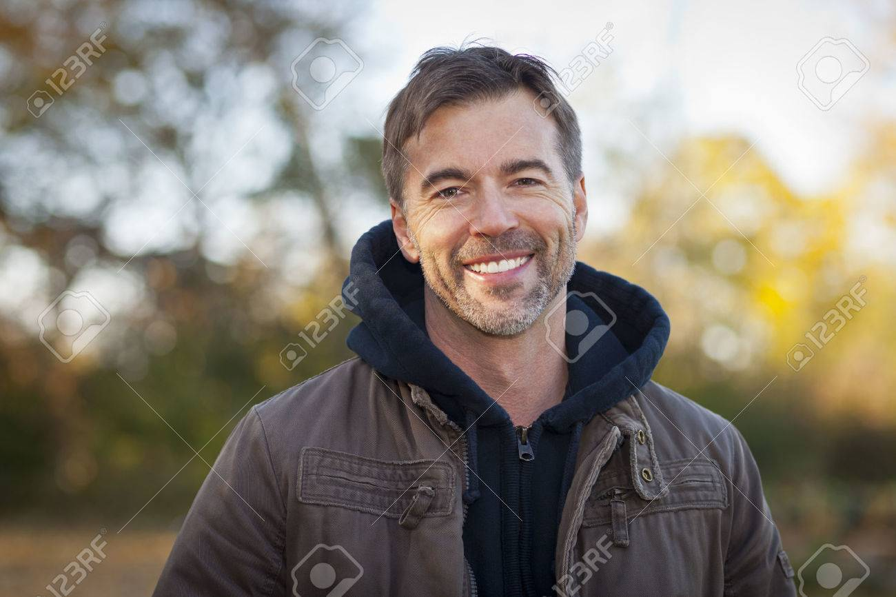 Portrait of A Mature Man Smiling At The Park - 52189843