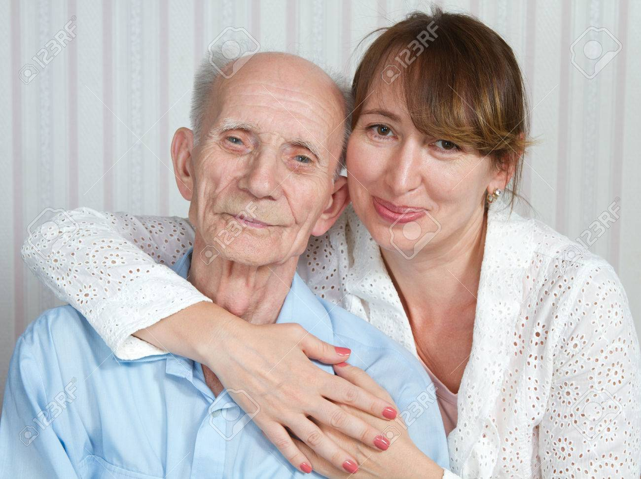Senior man, woman with their caregiver at home. Concept of health care for elderly old people, disabled Stock Photo - 27494612