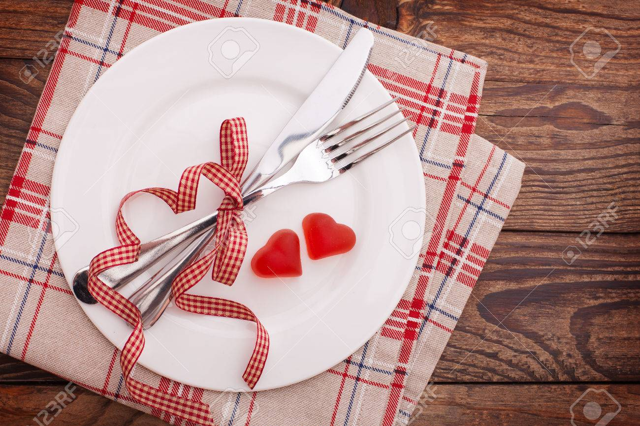 Table Setting Background valentines dinner on wooden background. table setting for
