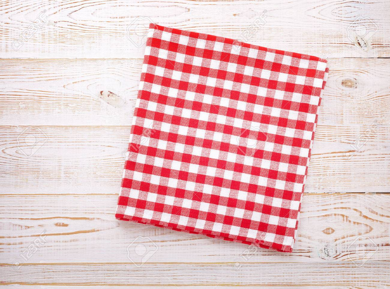 wooden kitchen table with empty red tablecloth for dinner view rh 123rf com kitchen tablecloths round kitchen tablecloth set