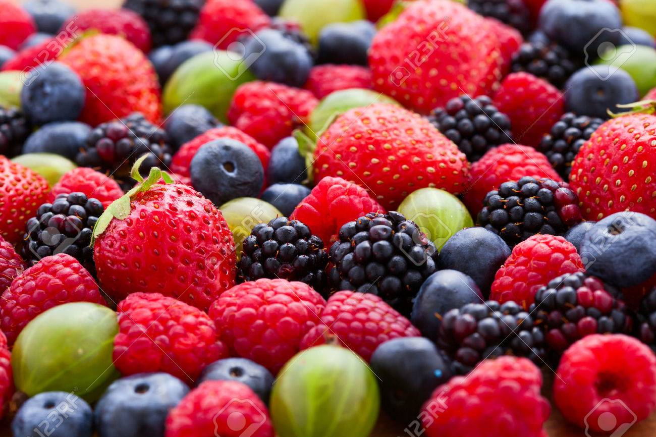 Berries Background macro, selective focus. Raspberries appetizing, natural blueberry, juicy strawberries, ripe gooseberries. Fruit Mix like bright background - 53039189
