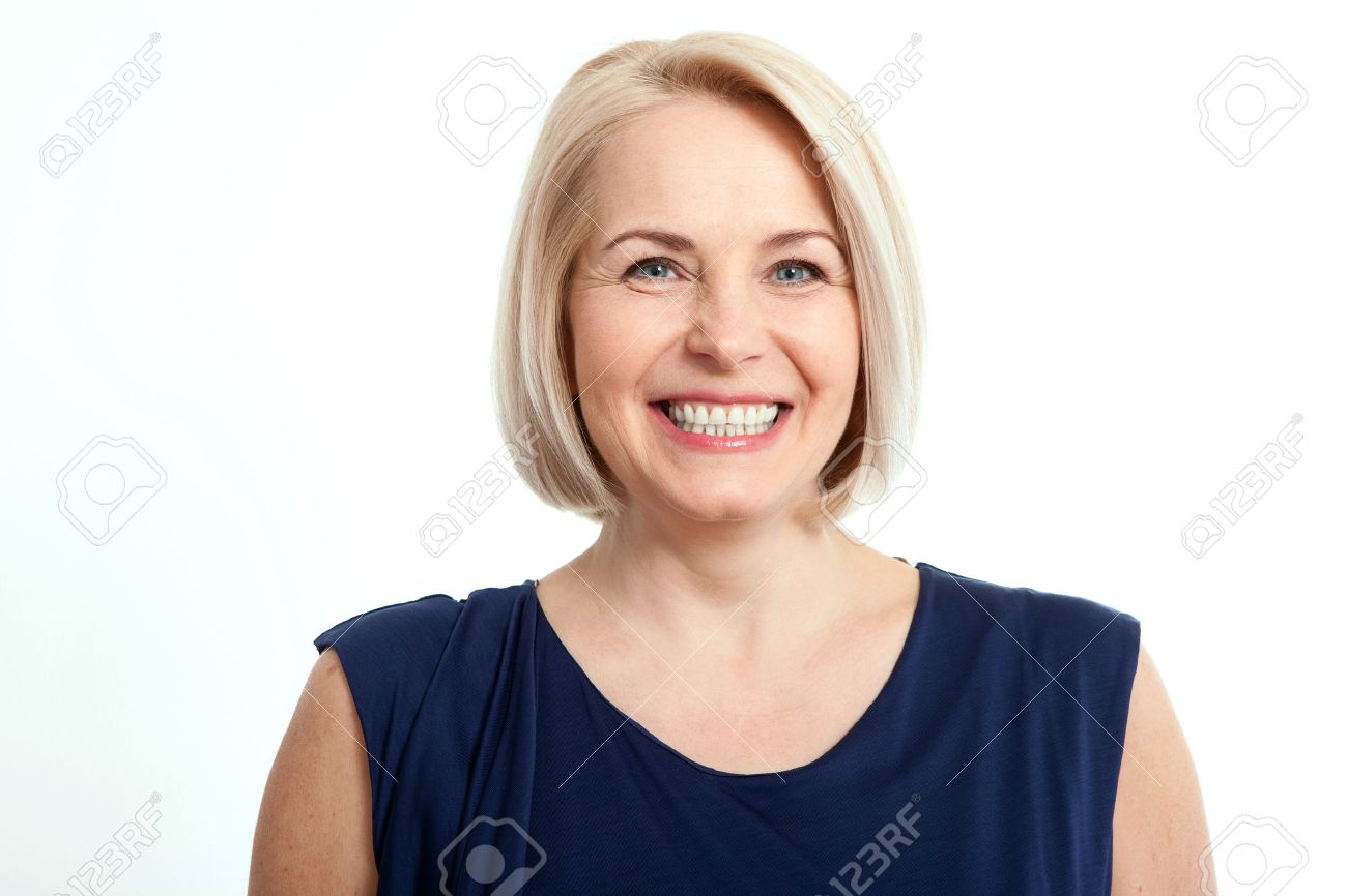 Friendly smiling middle-aged woman isolated on white background - 57872561