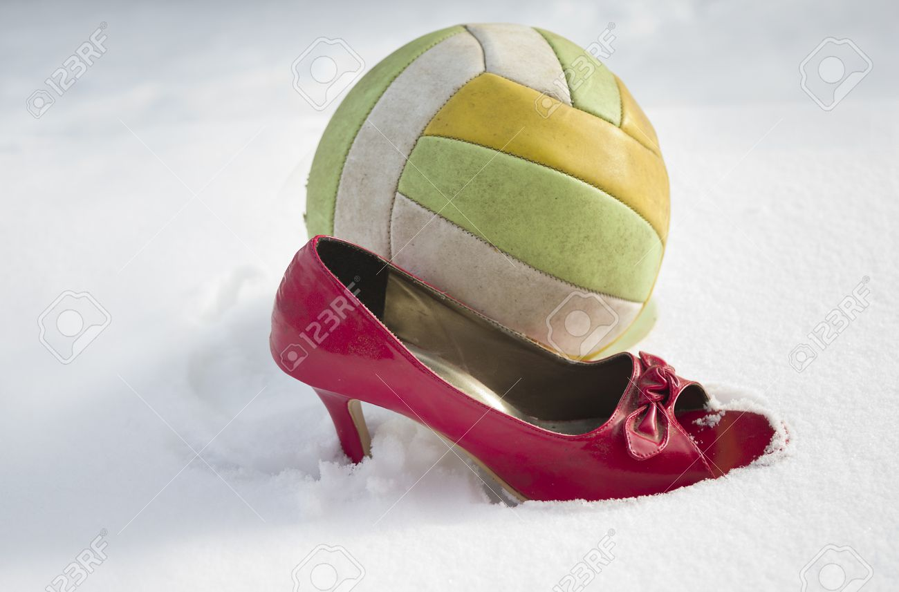 5cbcc5fa82b8 Side Shot Of A Football Ball And Red High Heel On The Snow