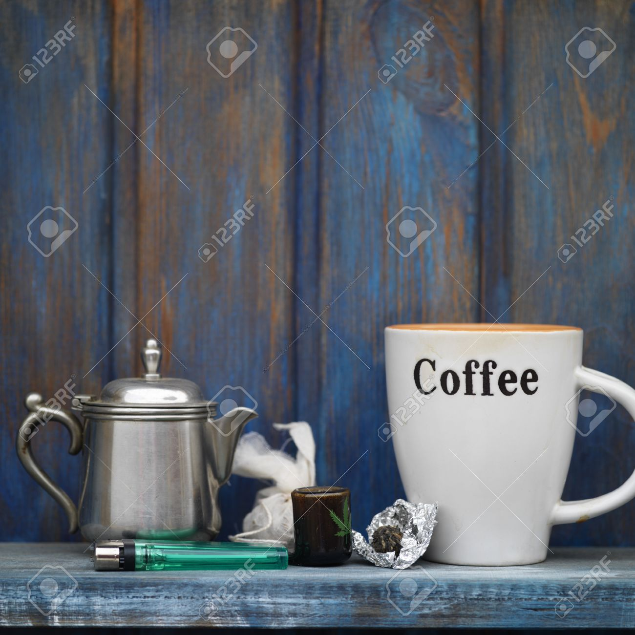 Still life of a marijuana next to a smoking pipe and coffee pot and mug & Still Life Of A Marijuana Next To A Smoking Pipe And Coffee Pot ...