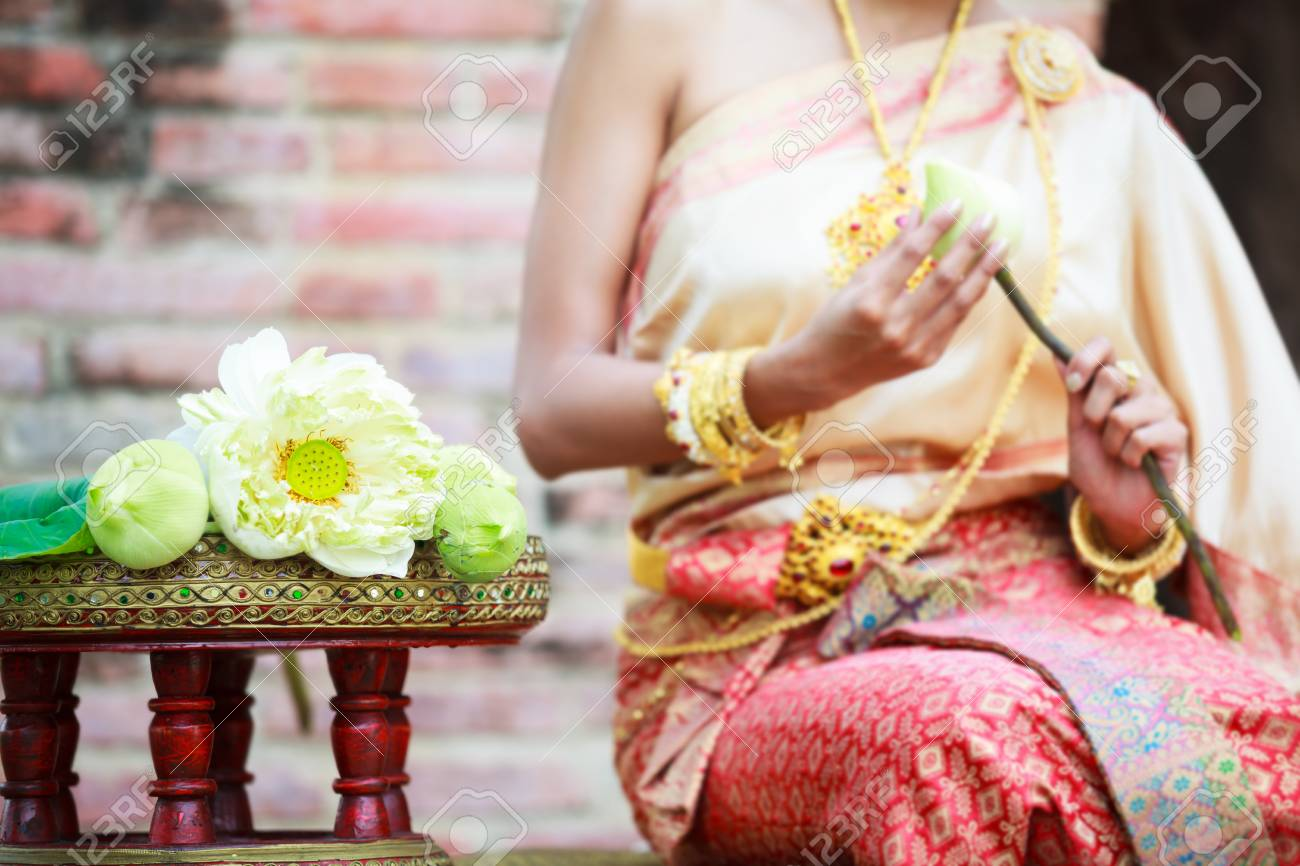 Woman In Traditional Clothes Fold Lotus Flower Petals Used In