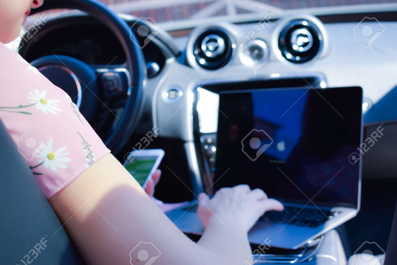 Work in the journey. Professional woman inside an expensive car. Working environment. - 146631269