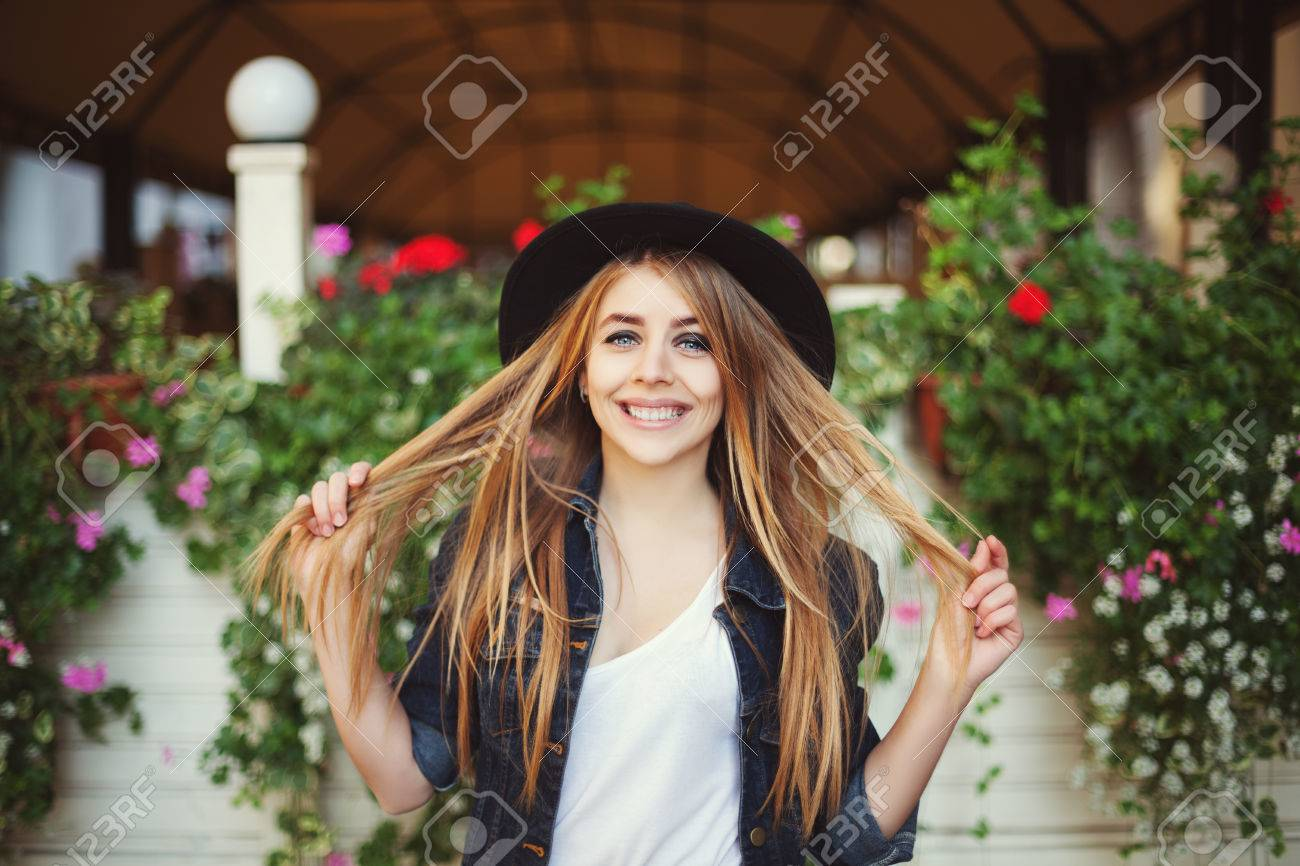 portrait of cute naughty girl playing with her hair. colorful