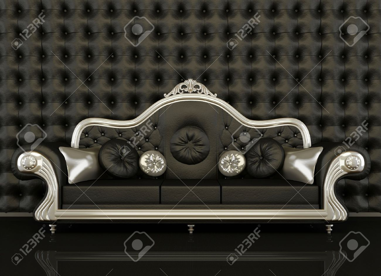 Classic Leather Sofa With A Silver Frame On Black Background. Button  Background Of Black Wall