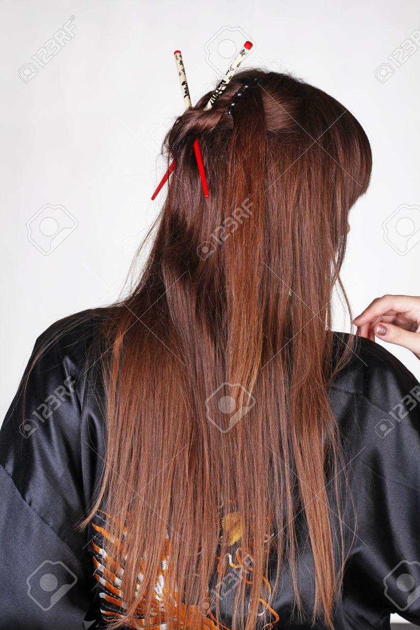 Japanese Geisha With Red Chopsticks In Hairstyle Long Hair Stock