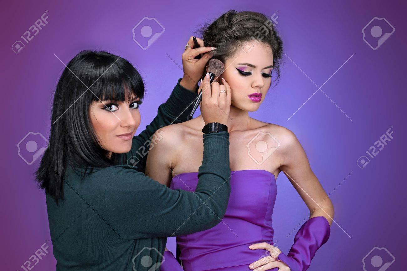 Professional Make-up artist doing model makeup at work Stock Photo - 11405412