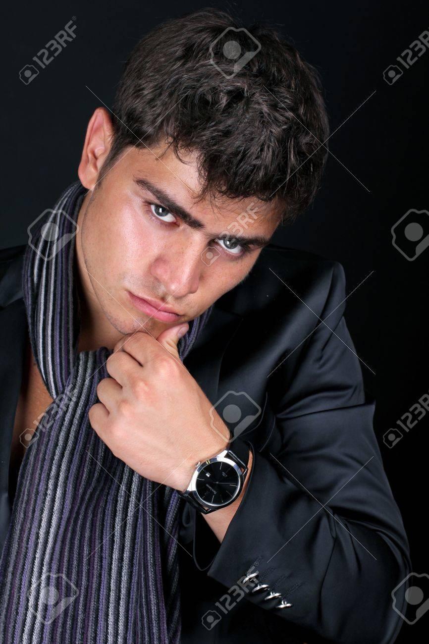 Elegant young handsome man,  intense gaze Stock Photo - 11933852