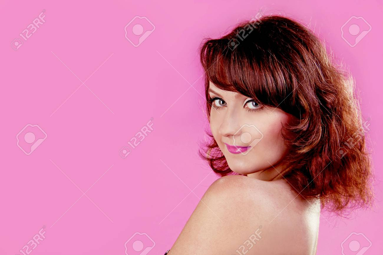 Beauty Portrait of Young woman over pink  Curly Hair Stock Photo - 13599356
