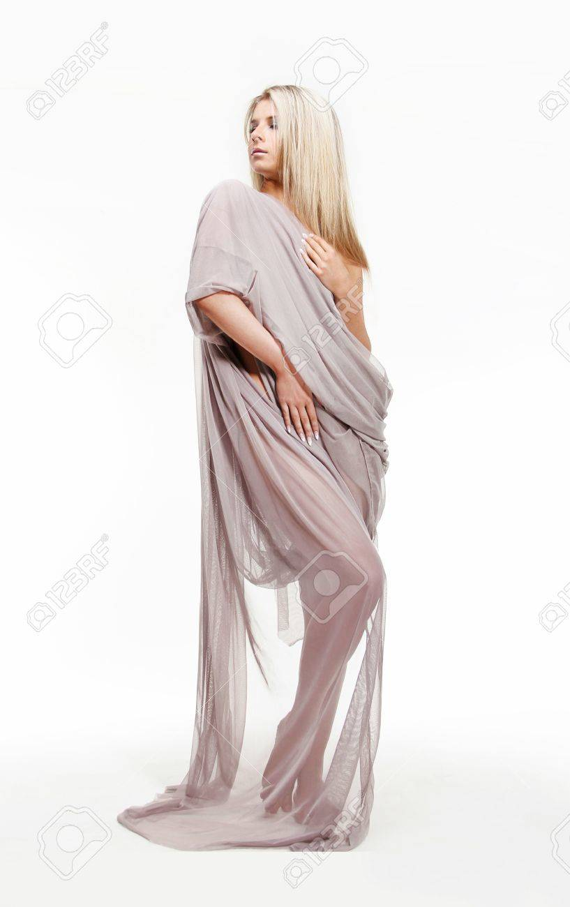 Portrait of beautiful sexy young woman in drapery dress Stock Photo - 13842120