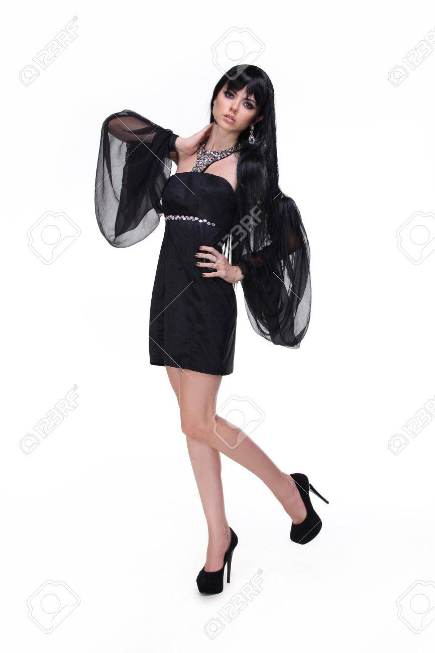 Fashion girl  in black dress and trendy shoes isolated on white Stock Photo - 14886548