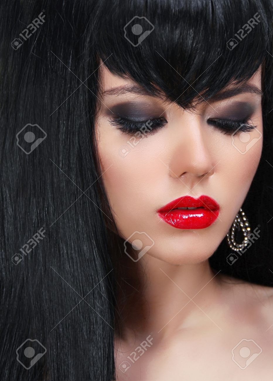 Fashion brunette woman portrait with red lips and Long Hair. Stock Photo - 15610591