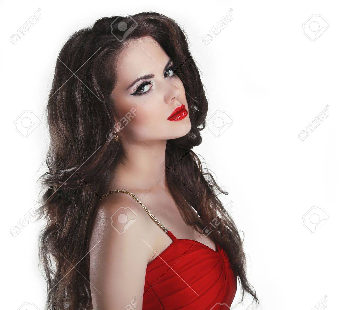 Portrait of beautiful brunette woman with red lips and curly hairs in dress Stock Photo - 16018245