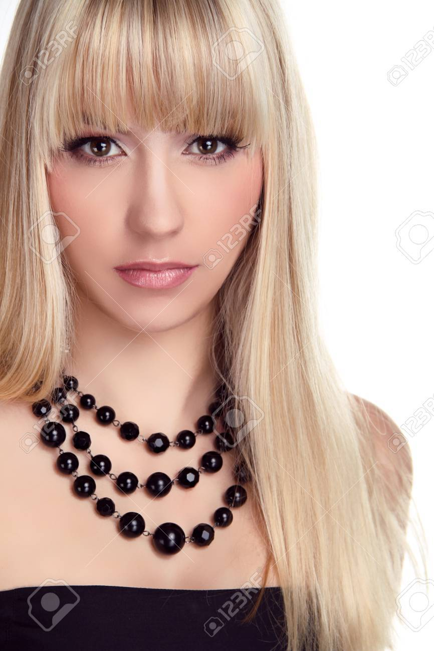 Beautiful blond woman with long hair styling isolated on white background. Fashion and Jewelry Stock Photo - 16794795