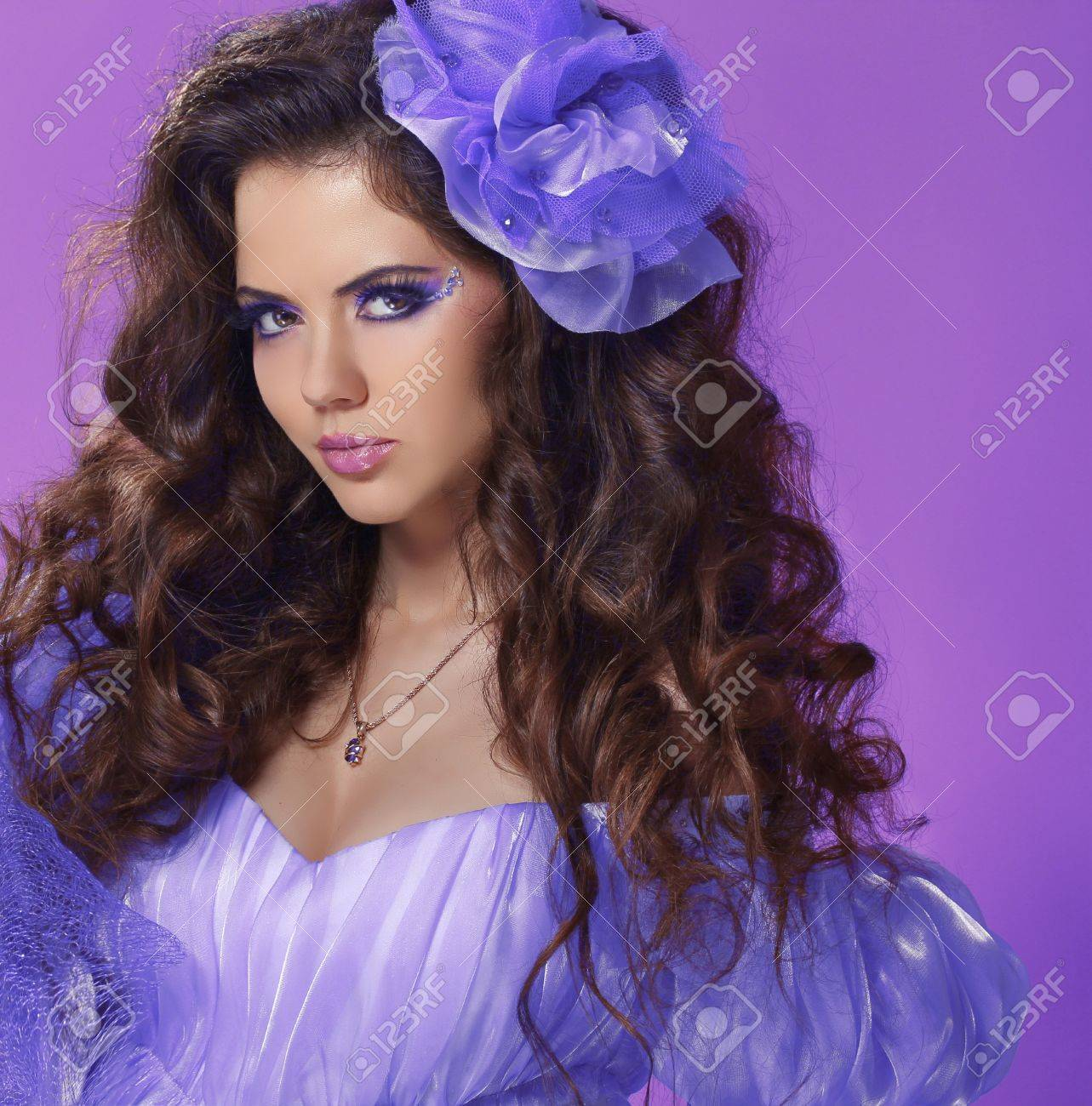 Woman with beauty long brown hair, luxury lady over purple Stock Photo - 16826048