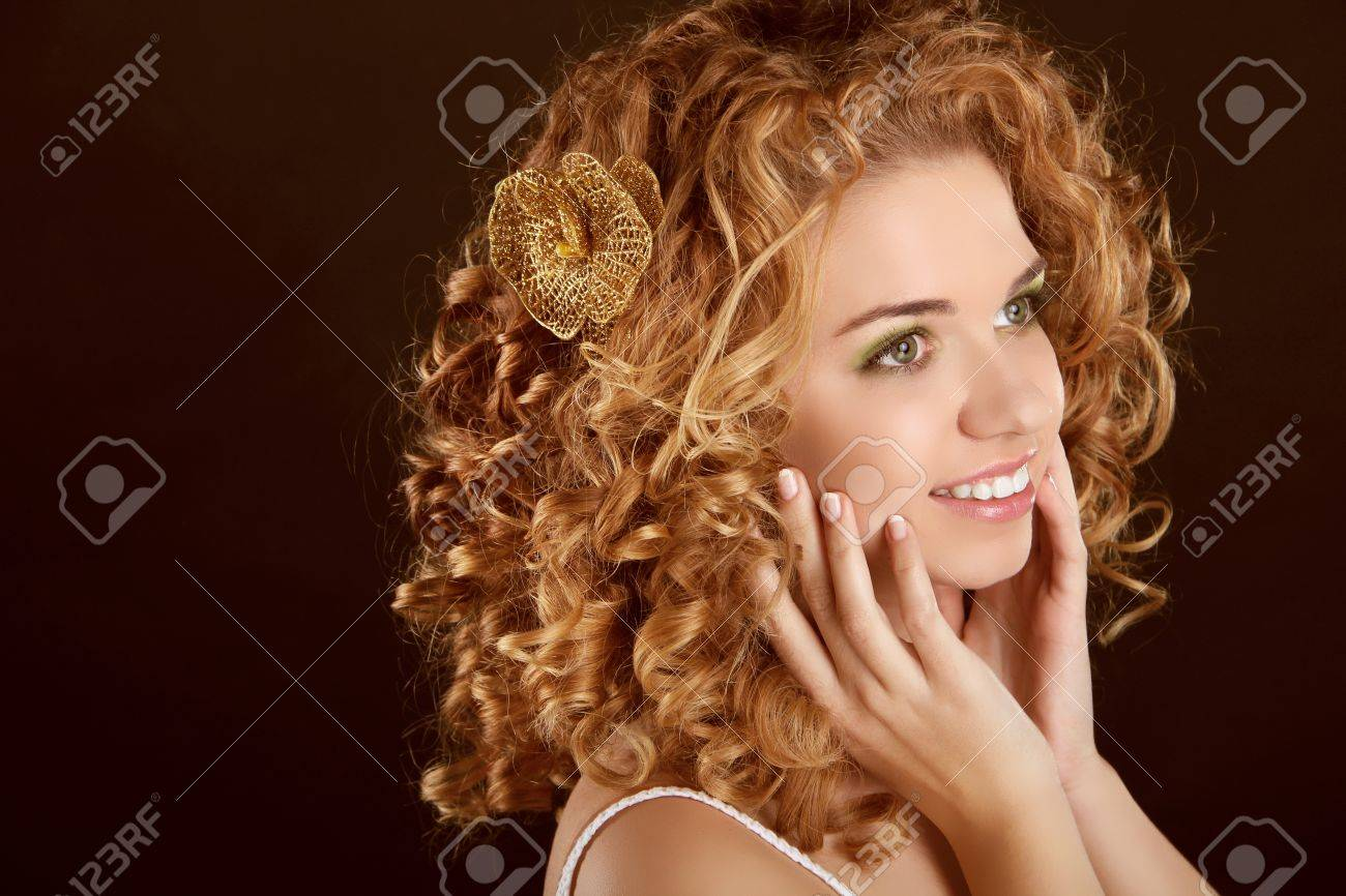 Curly Hair. Attractive smiling woman portrait on dark background. Beauty Portrait. Stock Photo - 16960616