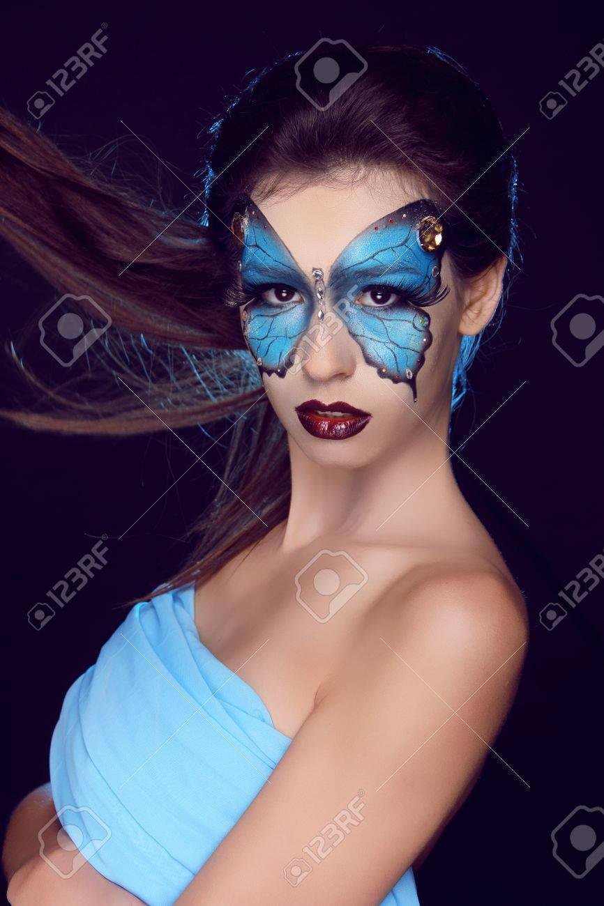 Fashion woman Portrait. Butterfly makeup,  face art make up Stock Photo - 17852083