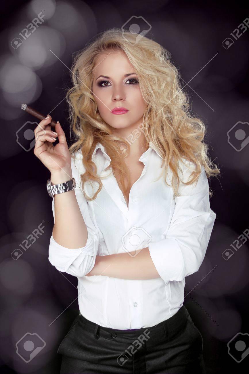 Sexy smoking beautiful woman cigar closeup studio shot Stock Photo -  17852101