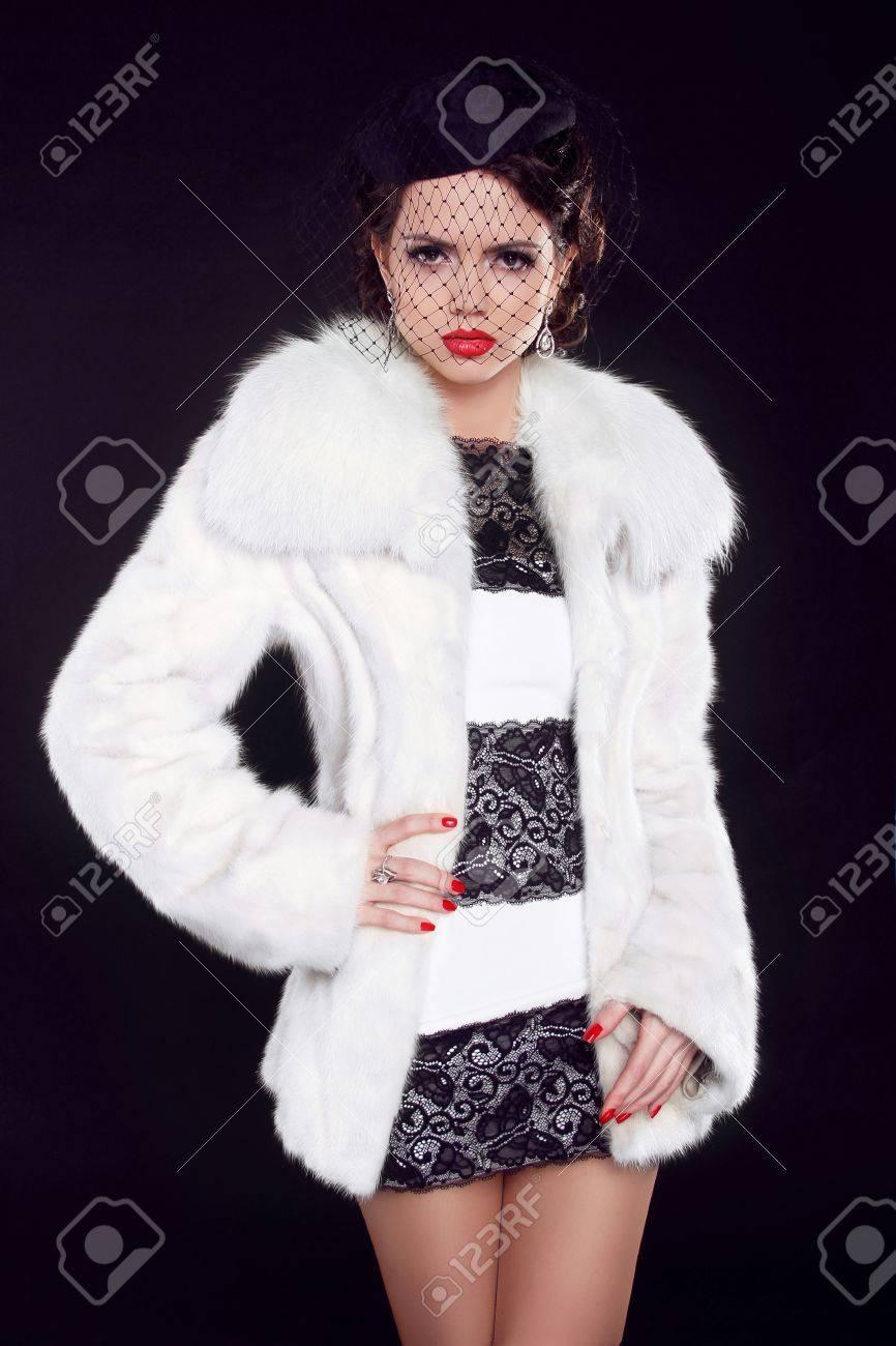 Winter Girl in Luxury Fur Coat, Fashion lady isolated on black background Stock Photo - 18184949