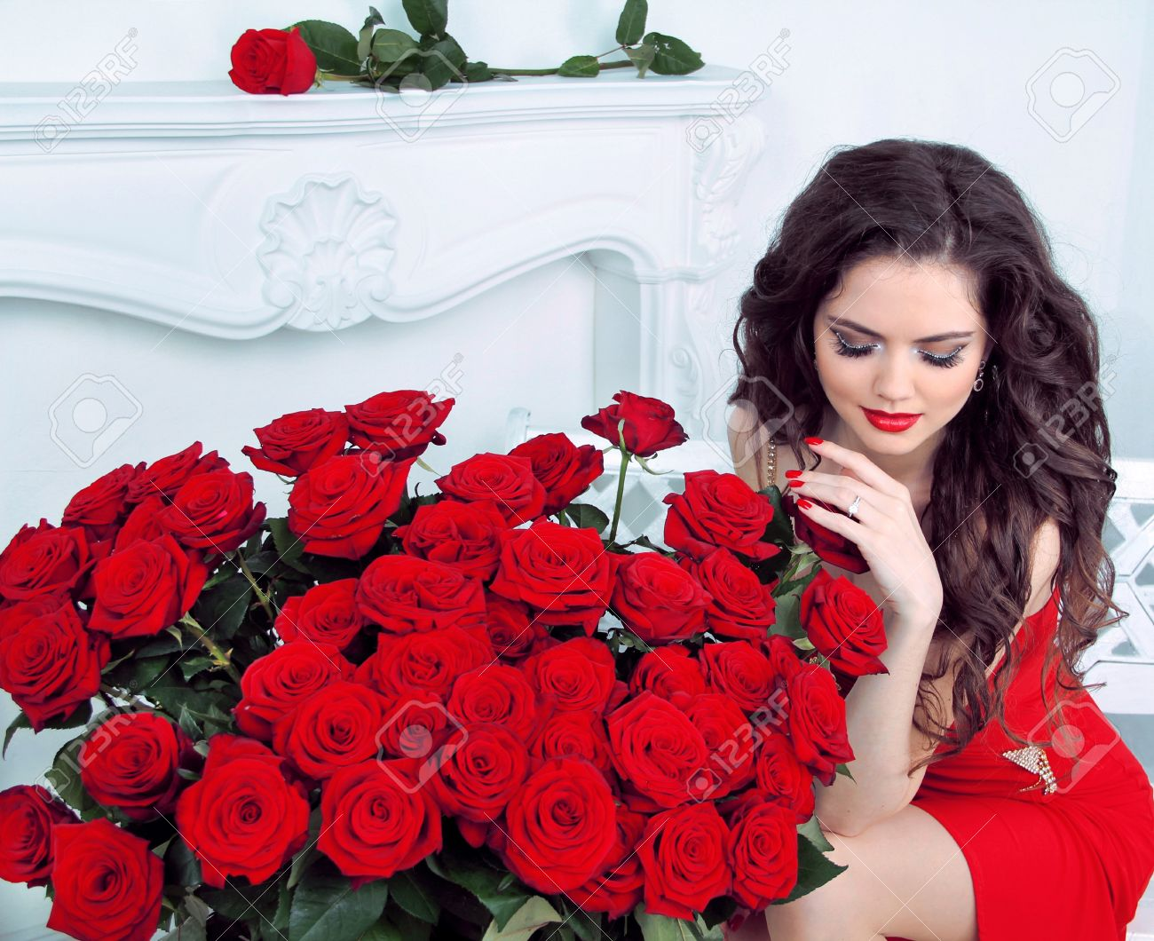 Beautiful young woman with red roses flowers bouquet in modern beautiful young woman with red roses flowers bouquet in modern interior apartment stock photo 19399167 izmirmasajfo Images