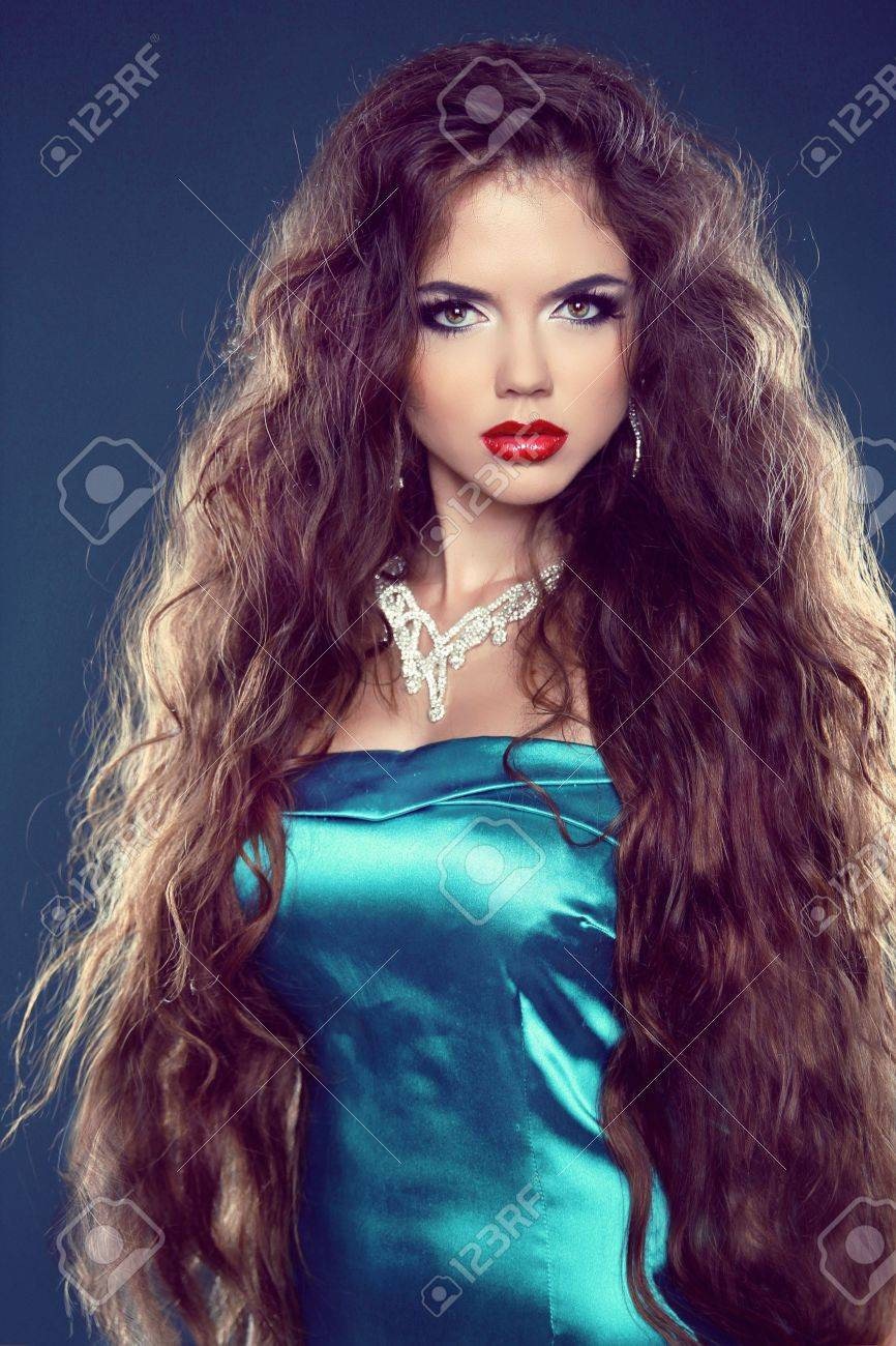 Hair. Beautiful Brunette Girl With Jewelry. Healthy Long Hair. Beauty Model Woman. Hairstyle Stock Photo - 21893413