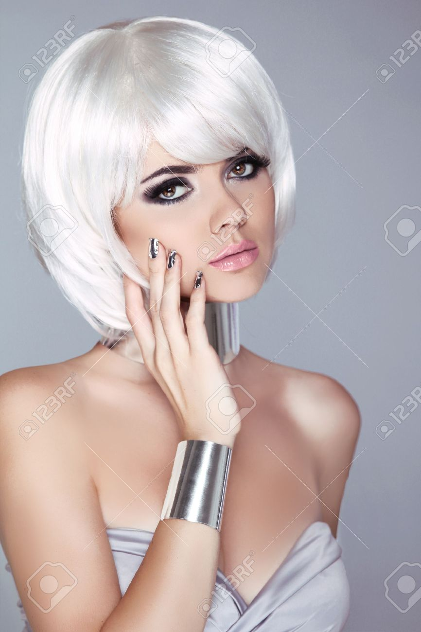 Fashion Blond Girl. Beauty Portrait Woman. White Short Hair. Isolated on Grey Background. Face Close-up. Haircut. Hairstyle. Fringe. Vogue Style. Stock Photo - 22183294