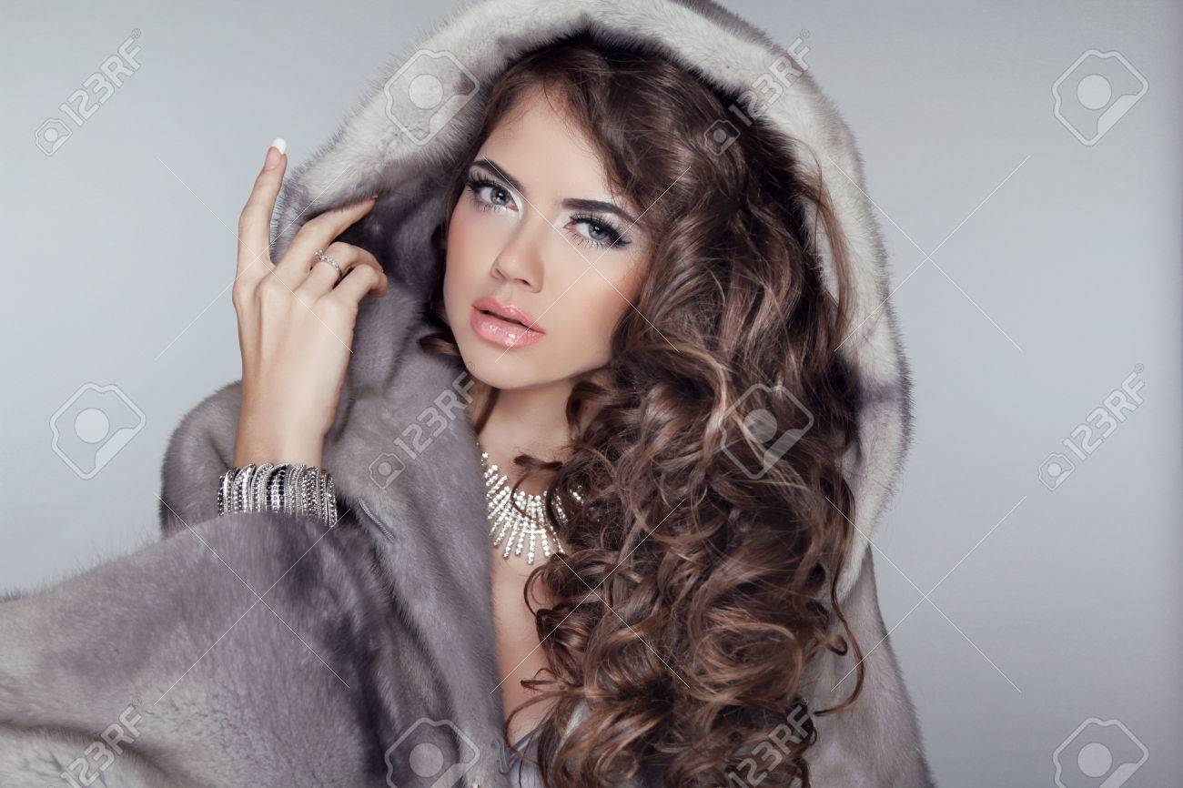 Beautiful brunette with long curly hairstyle Stock Photo - 24124164