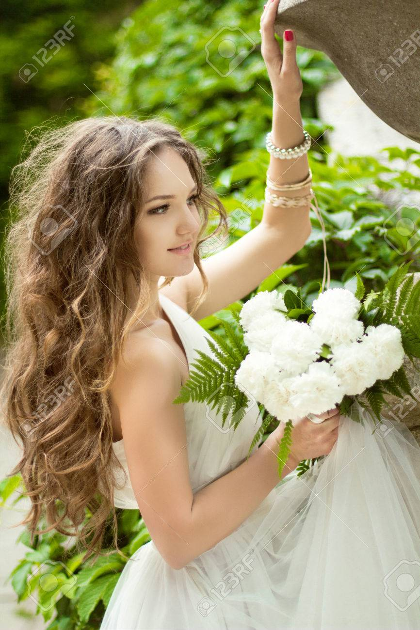 Beautiful Happy Bride With Long Wavy Hair And Wedding Makeup
