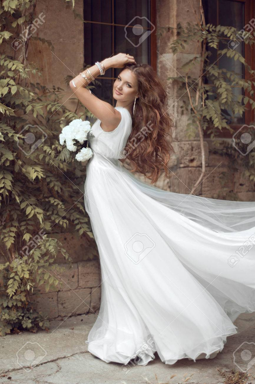 Beautiful Brunette Bride Woman With Long Wavy Hair In Luxurious ...